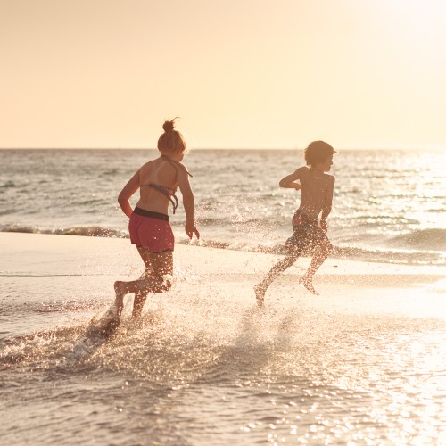 Children playing in water at the beach