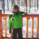 Boy dressed in ski clothes with helmet and googles