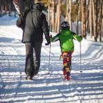 Boy and his father set off for a day skiing