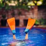 Boy wearing fins in a pool
