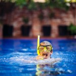 Boy wearing a snorkel set in a pool